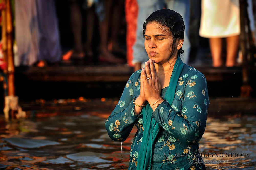 A Hindu devotee prays  in the middle of the Sangam, after washing sins away. Bathing on the new moon day, Amavasya is considered as the most auspicious and attaches the highest spiritual merit.