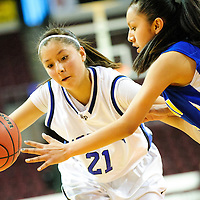 031213  Adron Gardner/Independent<br /> <br /> Navajo Pine Warrior Kaitlin Chee (21) drives past Zuni Thunderbird Shania Seciwa (3) during the 2A New Mexico High School Basketball tournament quarterfinals at the Santa Ana Star Center in Rio Rancho Tuesday.