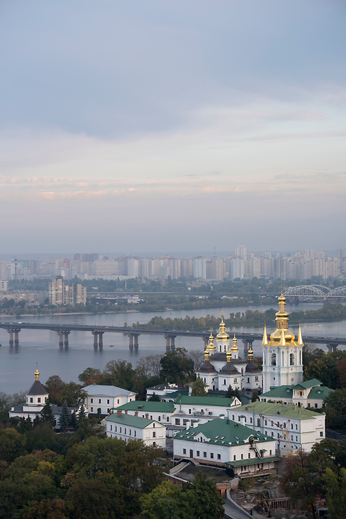 View from the Kiev Pechersk Lavra, a monastic center and UNESCO World Heritage Site in Kiev, Ukraine. In view are the Church of the Virgin Nativity with its adjacent Kovnirs Bell Tower, and the Dnieper River.