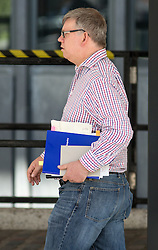 "© Licensed to London News Pictures. 06/07/2016. London, UK. A man leaves QEII Cente on the day Sir John Chilcot's The Report of the Iraq Inquiry is published, with a note in the volume he is carrying reading ""did Hitler"". The Inquiry was predicated to take approximately one year, but has taken seven. Photo credit : Tom Nicholson/LNP"