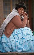 Woman in main plaza of Puno, Peru