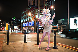 """© Licensed to London News Pictures . 04/04/2015 . Manchester , UK . Drag Queen """" Cheddar Gorgeous """" opposite the Corner House . Final party at the Corner House 's historical location on Oxford Road , before moving to First Street under a new name . Featuring several dance floors , drag queens , dance and performance art displays . Photo credit : Joel Goodman/LNP"""
