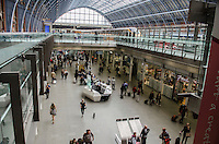 General view, shopping area, St Pancras Railway Station, London, UK. On the upper level to the right is from where the Eurostar trains to Continental Europe depart. A Eurostar train can be seen on the platform. 201609044285<br /> <br /> Copyright Image from Victor Patterson, 54 Dorchester Park, Belfast, UK, BT9 6RJ<br /> <br /> t1: +44 28 9066 1296 (from Rep of Ireland 048 9066 1296)<br /> t2: +44 28 9002 2446 (from Rep of Ireland 048 9002 2446)<br /> m: +44 7802 353836<br /> <br /> e1: victorpatterson@me.com<br /> e2: victorpatterson@gmail.com<br /> <br /> The use of my copyright images is subject to my Terms & Conditions.<br /> <br /> It is IMPORTANT that you familiarise yourself with them. They are available on my website at www.victorpatterson.com.<br /> <br /> None of my copyright images may be used on a website unless they are visibly watermarked, i.e. © Victor Patterson within the body of the visible image. Metadata denoting my copyright must NOT be deleted. Maximum online size is 300 kbs. Web use is extra at currently recommended NUJ rates.