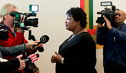 October 31, 2018 - Atlanta, Georgia, U.S. -  STACEY ABRAMS, Democratic candidate for governor of Georgia, speaks with the media during a breakfast stop at Emerald City Bagels.(Credit Image: © Brian Cahn/ZUMA Wire)