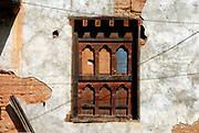 A traditional Bhutanese wooden windowframe boarded up in the plaster wall of a derelict building  Paro, Druk Yul Kingdom of Bhutan. 10 November 2007