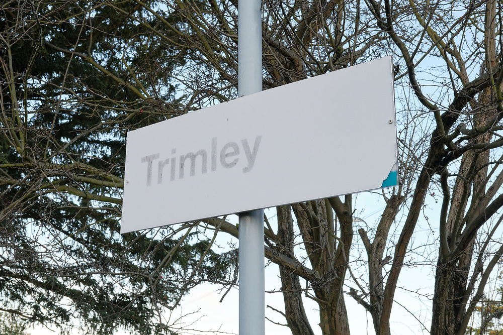 The Trimley sign at their station is faded & the previous sign   from a previous rail company can been seen where it has been damaged.<br /> <br /> Photo by Jonathan J Fussell, COPYRIGHT 2020