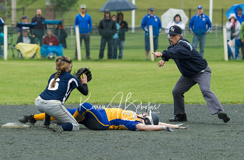 Franklin's Katlyn Nelson makes the out on Franklin's Anna Doherty during NHIAA Dvision III softball state championships at PSU Saturday afternoon.  (Karen Bobotas/for the Laconia Daily Sun)