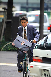 Businessman On Bicycle
