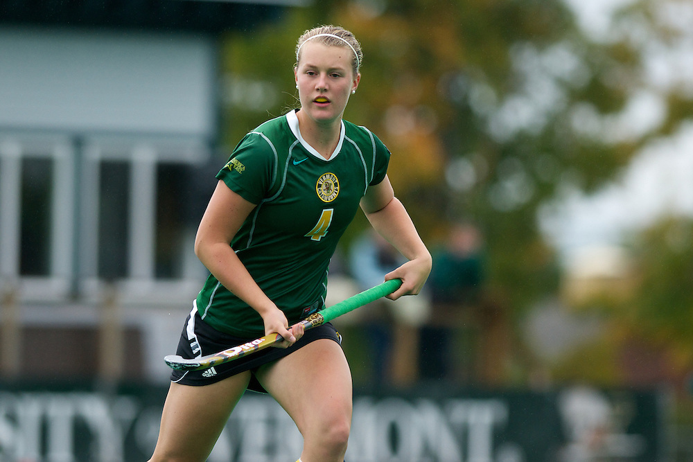 Catamounts midfielder Molly Higgins (4) in action during the women's field hockey game between the Maine Black Bears and the Vermont Catamounts at Moulton/Winder Field on Saturday afternoon September 29, 2012 in Burlington, Vermont.