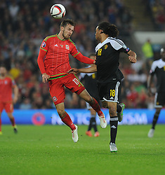Jason Denayer of Belgium (Celtic) wins the ball over Aaron Ramsey of Wales (Arsenal) - Photo mandatory by-line: Alex James/JMP - Mobile: 07966 386802 - 12/06/2015 - SPORT - Football - Cardiff - Cardiff City Stadium - Wales v Belgium - Euro 2016 qualifier