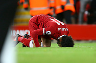 Mohamed Salah of Liverpool kisses the ground as he celebrates after scoring his teams 1st goal. Premier League match, Liverpool v Chelsea at the Anfield stadium in Liverpool, Merseyside on Saturday 25th November 2017.<br /> pic by Chris Stading, Andrew Orchard sports photography.