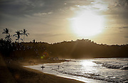 """SHOT 2/5/16 5:21:35 PM - A lone surfer takes to the water as the sun sets one evening in Sayulita, Mexico. Sayulita is a village about 25 miles north of downtown Puerto Vallarta in the state of Nayarit, Mexico. Known for its consistent river mouth surf break, Sayulita was """"discovered"""" by roving surfers in the late 1960s with the construction of Mexican Highway 200. Today, Sayulita is a prosperous growing village of approximately 5,000 residents. Hailed as a popular off-the-beaten-path travel destination, Sayulita offers a variety of activities such as horseback riding, hiking, jungle canopy tours, snorkeling and fishing. Still a mecca for beginner surfers of all ages, the quaint town attracts upscale tourists with its numerous art galleries and restaurants as well.(Photo by Marc Piscotty / © 2016)"""