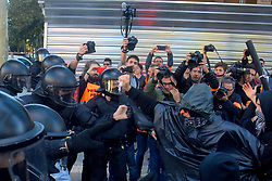 November 10, 2018 - Barcelona, Barcelona, Spain - Catalan police officers seen charging and clashing with the protesters in the presence of media during the demonstration..The Catalan Police (Mossos d'Escuadra) has charged against a group of protesters in their CDR majority (committee in defense of the Republic) when they were protesting during the demonstration of the Union JUSAPOL defending the salaries of the agents of the National Police Spanish and the Civil Guard asking for wage equalization. (Credit Image: © Ramon Costa/SOPA Images via ZUMA Wire)