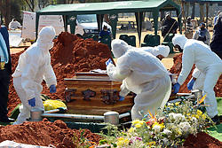 South Africa  - Johannesburg – Covid funeral.  Nathan van Rooi who died of covid-19 related complications is buried at Wespark cemetery on Thursday. The family followed the restrictions imposed by authorities and could not carry the coffin or close the grave.  He was buried a day after what would have been his 58th birthday. Picture: Timothy Bernard/African News  Agency(ANA)
