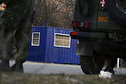 """Local Serbs, in Northern Mitrovica, open a Serbian Check point<br /> <br /> Northern Mitrovica, Kosovo<br /> Sunday, February 24, 2008<br /> <br /> Around 12/km far away from Southern Mitrovica, local Serbs from Zubin Potok suburban villages, 200metters near entrance of Qabre village populated with Albanians, put a barrack with close blue color, which means """"check point""""<br /> One of them, who doesn't preferred to tell his name says """"Here is going to be the border between Kosovo and Serbia, but what ever Kosovo is also Serbia, we will not let it go away of our hands""""<br /> On this point arrived many Danish KFOR soldiers, and situation become calm, Danish KFOR took that barrack and order Serbs to brake it away. According to some internal sources from the Serbian side, they're gone put it on next few 200metters away, from this point where they already put it today, and use to try and controlling civilian vehicles.<br /> PICTURED: Behind Danish KFOR military police forces, a view of Serbian new line border, of blue barrack in SouthWestern Mitrovica<br /> Photographer VEDAT xhymshiti/ZUMApress"""