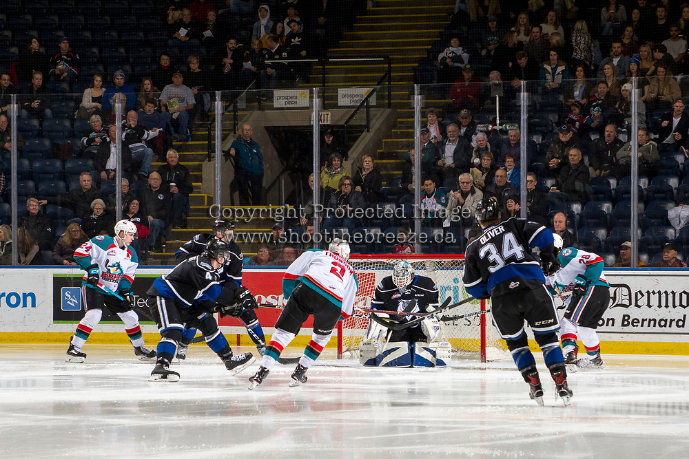 KELOWNA, CANADA - JANUARY 25: Griffen Outhouse #30 of the Victoria Royals makes a save on a shot by Lassi Thomson #2 of the Kelowna Rockets on January 25, 2019 at Prospera Place in Kelowna, British Columbia, Canada.  (Photo by Marissa Baecker/Shoot the Breeze)