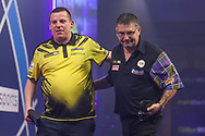 Dave Chisnall congratulates Gary Anderson who wins the match during the William Hill World Darts Championship Semi-Finals at Alexandra Palace, London, United Kingdom on 2 January 2021.