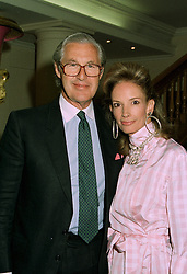 MR & MRS MARTIN SUMMERS he is the leading art dealer, at a party in London on 16th 1997.LZJ 40