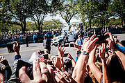 "Spectators cheer for Pope Francis as he passes by in his ""popemobile,"" a specially designed Jeep Wrangler with a glass-enclosed roof, as he is driven on the streets around the Ellipse, south of the White House in Washington, District of Columbia, U.S., on Wednesday, Sept. 23, 2015."