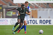 Freddie Ladapo (19) of Plymouth Argyle battles with James Clarke (15) of Bristol Rovers during the EFL Sky Bet League 1 match between Bristol Rovers and Plymouth Argyle at the Memorial Stadium, Bristol, England on 8 September 2018.