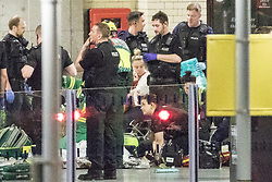 © Licensed to London News Pictures. FILE PICTURE DATED 23/05/2017 as Manchester prepares to mark a year since the Manchester Arena terror attack . Manchester, UK. Police and other emergency services tending to injured people on the platform at Victoria Station near the Manchester Arena after reports of an explosion. Police and other emergency services are seen near the Manchester Arena after Salman Abedi murdered 22 and injured dozens more at an Ariana Grande concert at Manchester Arena. Photo credit: Joel Goodman/LNP