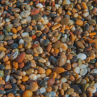 Tiny colorful pebbles, rounded by wave action, provide the namesake for Pebble Beach, part of Bean Hollow State Beach on the Pacific Ocean coast of California.