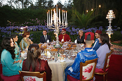 In this photo dated Wednesday, June 14, 2017 Morocco's King Mohammed VI, center right, his wife Princess Lalla Salma, background left, French President Emmanuel Macron, center left, and his wife Brigitte Macron, background right, attend an Iftar meal, the evening meal when Muslims end their daily Ramadan fast at sunset, at the King Palace in Rabat, Morocco. Clockwise from left : Princess Lalla Oum Kaltoum, Princess Lalla Salma, Crown prince Moulay Hassan, Princess Lalla Hasnaa, Prince Moulay Rachid, Brigitte Macron, King Mohammed VI, Emmanuel Macron, Princess Lalla Salma, Princess Lalla Meryem. Photo by Abdeljalil Bounhar/Pool/ABACAPRESS.COM