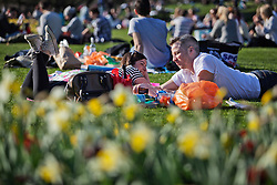 © Licensed to London News Pictures. 09/03/2014. London, UK. Thanks to the temperature that has reached 20 degrees, thousand of Londonians have poured out in Hyde Park enjoying a spring warm day. Photo credit : Andrea Baldo/LNP