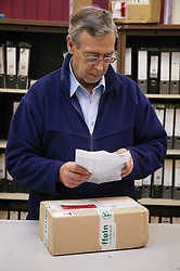 Logistic Operative checking incoming parcel into the stores at the Hospital before distributing to appropriate department,