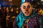 New York, NY, October 31, 2013. A man costumed as a  malevolent jester in the Greenwich Village Halloween Parade.