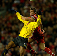 Photo: Paul Greenwood.<br />Liverpool v Arsenal. The FA Cup. 06/01/2007. Arsenal's Gilberto, left, looses out in the air to Liverpool's Xavi Alonso