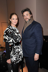 TRINNY WOODALL and the EARL OF ALBEMARLE at a party to celebrate the publication of Nathalie von Bismarck's book 'Invisible' held at Asprey, 167 New Bond Street, London on 9th December 2010.