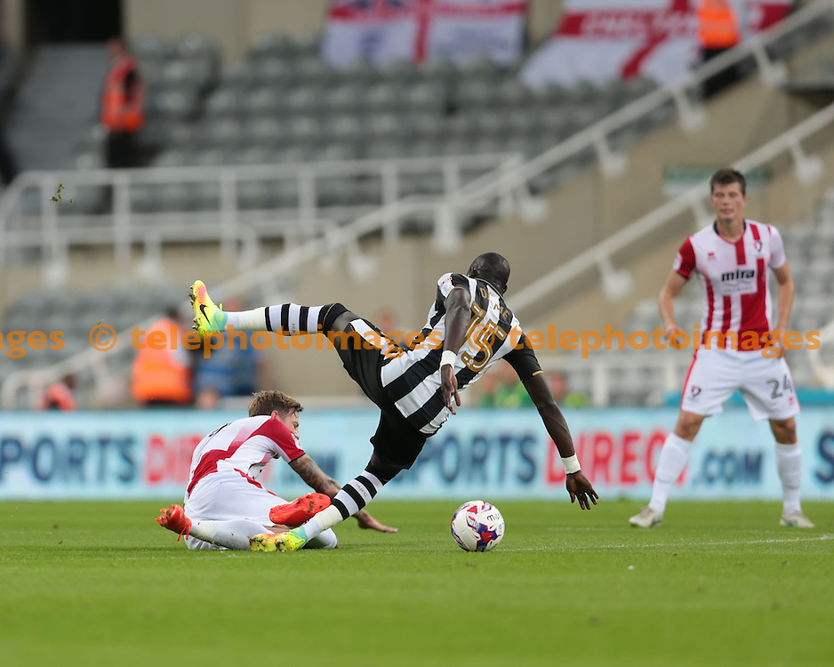 Cheltenham Town midfielder Asa Hall (14) is fouled by Newcastle United midfielder Mohamed Diame (15) during the EFL Cup Round Two match between Newcastle United and Cheltenham Town at St. James' Park in Newcastle. August 23, 2016.<br /> Nigel Pitts-Drake / Telephoto Images<br /> +44 7967 642437