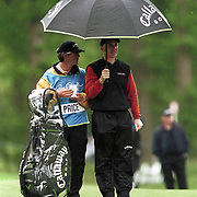 Wales' Philip Price shelters from the rain