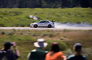 Image of a car blowing up at the finish line at the Sun Valley Road Rally, Idaho, Pacific Northwest by Randy Wells