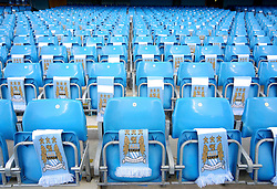 Manchester City scarves laid out on the seats at the Etihad Stadium before the UEFA Champions League group stage match between Manchester City and Juventus at the Etihad Stadium - Mandatory byline: Matt McNulty/JMP - 07966386802 - 15/09/2015 - FOOTBALL - Etihad Stadium -Manchester,England - Manchester City v Juventus - UEFA Champions League - Group D