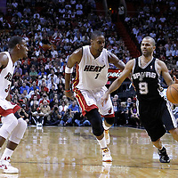17 January 2012: San Antonio Spurs point guard Tony Parker (9) drives past Miami Heat power forward Chris Bosh (1) during the Miami Heat 120-98 victory over the San Antonio Spurs at the AmericanAirlines Arena, Miami, Florida, USA.