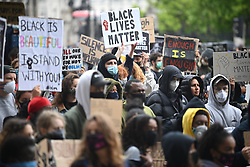 © Licensed to London News Pictures. 06/06/2020. London, UK. Protesters gather in Westminster, central London during a Black Lives Matter demonstration over the killing of African American George Floyd. The death of George Floyd, who died after being restrained by a police officer In Minneapolis, Minnesota, caused widespread rioting and looting across the USA. Photo credit: Ben Cawthra/LNP
