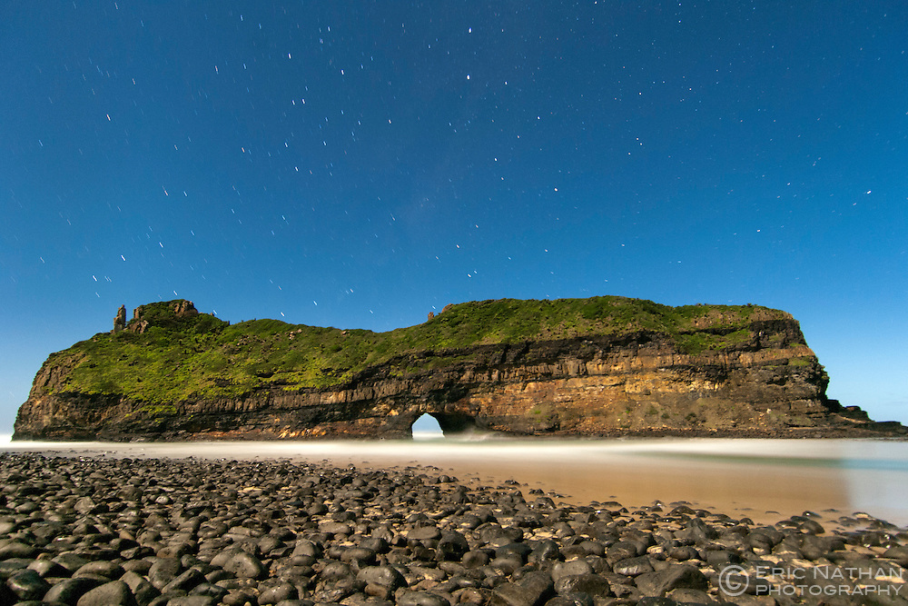 Moonlit, night-time view of Hole in the Wall, a rock formation on the coast of South Africa's Eastern Cape Province.