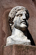 Decorative detail from the area surrounding Castel Sant'Angelo and the Ponte Sant'Angelo in Rome, Italy. Many decorative sculptural and architectural details adorn the length of the bridge, as well as the area surrounding it and the Castel Sant'Angelo. This image shows a bust of the Roman Emperor Hadrian.