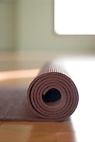Simple close up of a yoga mat rolled up in a yoga studio.<br /> :::<br /> The lesson which life repeats and constantly enforces is 'look underfoot.' You are always nearer the divine and the true sources of your power than you think. The lure of the distant and difficult is deceptive. The great opportunity is where you are. Do not despise your own place and hour. Every place is under the stars, every place is of the world. <br /> ~ John Burroughs
