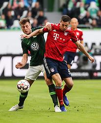 WOLFSBURG, Oct. 21, 2018  Bayern Munich's Robert Lewandowski (R) vies with Wolfsburg's Robin Knoche during a German Bundesliga match between Wolfsburg and Bayern Munich, in Wolfsburg, Germany, on Oct. 20, 2018. Bayern Munich won 3-1. (Credit Image: © Xinhua via ZUMA Wire)
