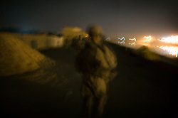 Paratroopers with Bravo Battery 2-319 2BCT 82nd Airborne Division patrol along the Tigris River to enforce a curfew and interdict weapons, insurgents, and miltiamen trying to cross the river under cover of night on Monday April 23, 2007