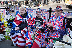 © Licensed to London News Pictures. 17/05/2018. Windsor, UK. Royal fans wrap up warm in Union flag decorated clothing and flags as they wait outside Windsor Castle two days ahead of the wedding of Prince Harry and Meghan Markle. Later a full military procession rehearsal will take place through the streets of Windsor. Photo credit: Peter Macdiarmid/LNP