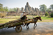19 MARCH 2006 - SIEM REAP, SIEM REAP, CAMBODIA: A horse cart goes by the Bayon temple in the Angkor Wat complex. The Bayon is a part of the Angkor Thom complex within Angkor Wat and was built in the 12 century by Buddhists.  Photo by Jack Kurtz / ZUMA Press