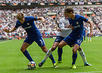 Football - 2017 / 2018 Premier League - Tottenham Hotspur vs. Chelsea <br /> <br /> Dele Alli (Tottenham FC) grabs a hold of Andreas Christensen (Chelsea FC) as Marcos Alonso (Chelsea FC) takes the ball at Wembley Stadium.<br /> <br /> COLORSPORT/DANIEL BEARHAM