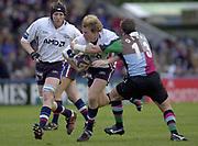 Twickenham, England, The Stoop, Surrey.<br /> 25/10/2003 - Photo  Peter Spurrier<br /> 2003_04 Zurich Premiership Rugby - Harlequins v Sale Sharks<br /> Quinns Mel Deane tackles Stuart Pinkerton