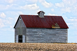 2012, March 18:  A farm building, Barn or crib sits idle in the barn lot with part of the roof missing..This image has been prepared using High Dynamic Rage (HDR) processes.