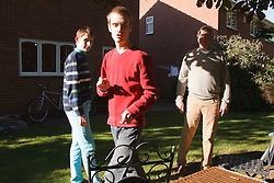 Young men with autism in garden with their father. Cleared for Mental Health issues.