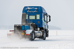 An Iveco Stralis races down the mile in the Baikal Mile Ice Speed Festival. Imagine a truck this heavy out in the middle of a lake! Maksimiha, Siberia, Russia. Thursday, February 27, 2020. Photography ©2020 Michael Lichter.